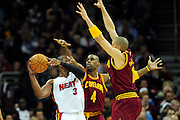 Dec. 2, 2010; Cleveland, OH, USA;  Miami Heat shooting guard Dwyane Wade (3) looks for a pass under pressure from Cleveland Cavaliers power forward Antawn Jamison (4) and shooting guard Anthony Parker (18) during the third quarter against the \ at Quicken Loans Arena. The Heat beat the Cavaliers 118-90. Mandatory Credit: Jason Miller-US PRESSWIRE