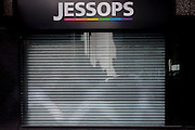 The metal shutters are down on the recently closed Jessops photo store in a side street of the City of London, the heart of the capital's financial district.  Jessops' store closures made over 1,350 staff redundant when they shut up shop at the start of the year with administrators PricewaterhouseCoopers admitting that at least some of the 192 stores would close. Other high-street chains such as HMV and the video chain, Blockbuster also closed at the beginning of 2013..