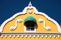 Oranjestad, Aruba, Lesser Antilles: A building with distinctive yellow with white trim, plus a green awning, is typical of the bright Dutch Colonial architecture found throughout this town.