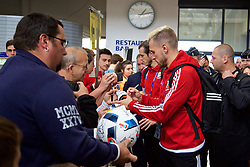 DINARD, FRANCE - Tuesday, July 5, 2016: Wales' Aaron Ramsey signs autographs as he departs from Aeroport De Dinard Pleurtuit Saint-Malo as they head to Lyon for their Semi-Final game against Portugal during the UEFA Euro 2016 Championship. (Pic by David Rawcliffe/Propaganda)
