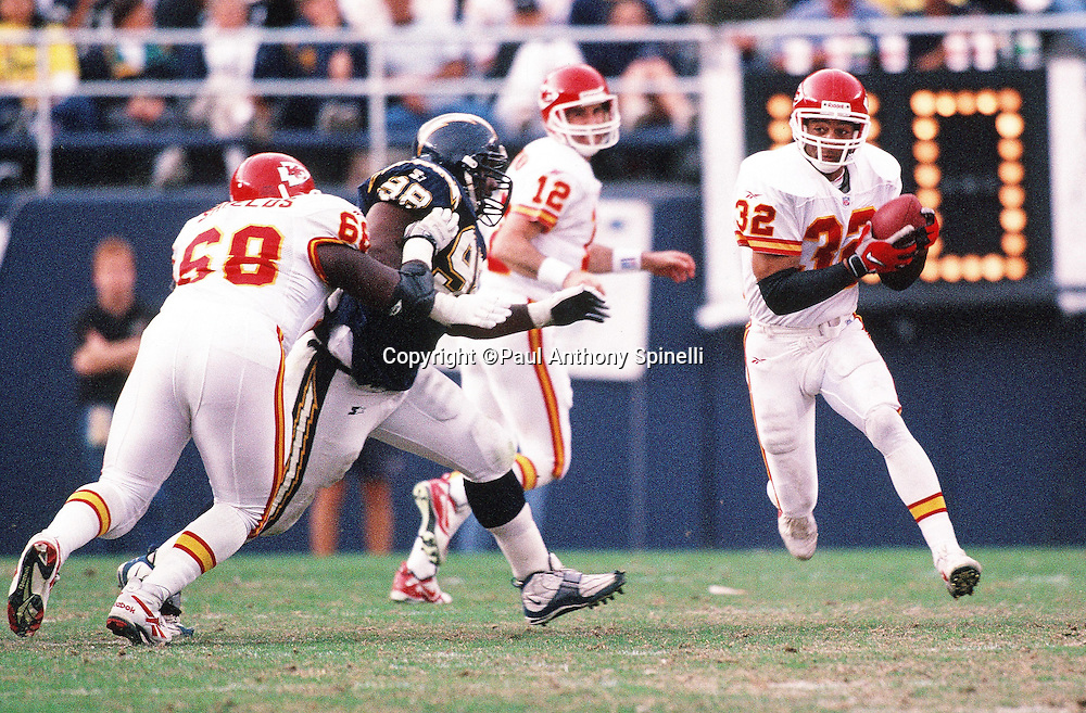 Kansas City Chiefs running back Marcus Allen (32) runs the ball during the NFL football game against the San Diego Chargers on Dec. 14, 1997 in San Diego. The Chiefs won the game 29-7. (©Paul Anthony Spinelli)
