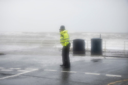 © London News Pictures. Aberystwyth, UK. 08/02/2016. Police at the scene as Gale force winds from Storm Imogen, the 9th named storm of the winter, combined with the peak of the tide, create huge waves  lashing against  the promenade and sea defences at Aberystwyth on the west Wales coast.  Much of southern England and South Wales is subject to yellow and amber weather warnings, with the risk of damaging gusts of wind and powerful waves along coastal areas. Keith Morris/LNP<br /> <br /> <br /> photo © Keith Morris
