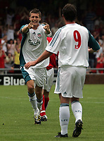 Photo: Paul Thomas.<br /> Crewe Alexandra v Liverpool. Pre Season Friendly. 22/07/2006.<br /> <br /> Goal scorer Craig Lindfield of Liverpool (L) celebrates with Robbie Fowler.