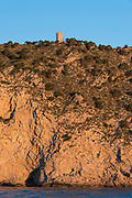 El Aguiló old tower is a defensive tower built in the 16th century, Villajoyosa village, Costa Blanca, Alicante province, Spain