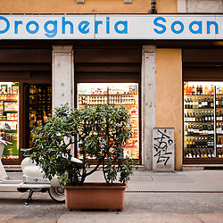 Milan, Italy - April 7, 2012: A parked Lambretta stands in front of Drogheria Soana, one of the typical grocery shops in the historical center of Milan.