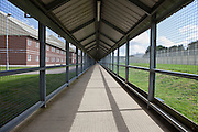 A secure walkway linking some of the prison buildings. HMP The Mount, Bovingdon, Hertfordshire