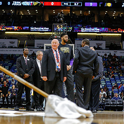 Feb 7, 2018; New Orleans, LA, USA; New Orleans Pelicans forward Anthony Davis (center) looks on as worker clean the court during a delay the game between the New Orleans Pelicans and the Indiana Pacers was postponed after a nearly two hour delay due to a roof leak at the Smoothie King Center. Mandatory Credit: Derick E. Hingle-USA TODAY Sports