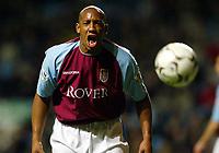 Photograph: Scott Heavey.<br /> Aston Villa v Portsmouth. FA Barclaycard Premiership. 06/01/2003.<br /> Dion Dublin vents his frustration at the linesman