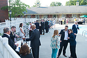 Ohio University Foundation Trustees, Faculty members, and other guests are served appetizers made with locally sourced ingredients that were curated by students in the Food Studies Theme by the pool at the Ohio University Inn and Conference Center on Friday, June 9, 2017. Each appetizer had a wine and beer pairing.