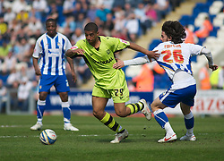 COLCHESTER, ENGLAND - Saturday, April 24, 2010: Tranmere Rovers' Joss Labadie and Colchester United's David Prutton in action during the Football League One match at the Western Community Stadium. (Photo by Gareth Davies/Propaganda)