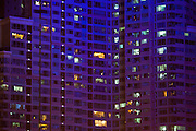 A night time view of a high rise apartment building in the southern factory city of Dongguan.