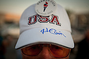 Ed Hendrickson shows off his support , and autograph, for Republican presidential candidate Herman Cain at the Dickinson County GOP Summer Picnic in Okoboji, Iowa, August 10, 2011.