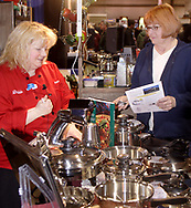 """Debbie O'Connell (left,) talks cookware with Lore Lammer, from Huber Heights in the Royal Prestige booth, during Miami Valley HomeWorld, at the Dayton Exposition Center in Vandalia, Saturday, February 10th.  Lore says, """"I need to change my way of eating."""" adding """"I married off the last kid, now it's all about me."""""""