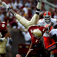 Florida State's Craphonso Thorpe drops a pass as he gets flipped during the first half of the game against Clemson on September 25, 2004 in Tallahassee, FL. The Seminoles beat the Tigers 41-22.