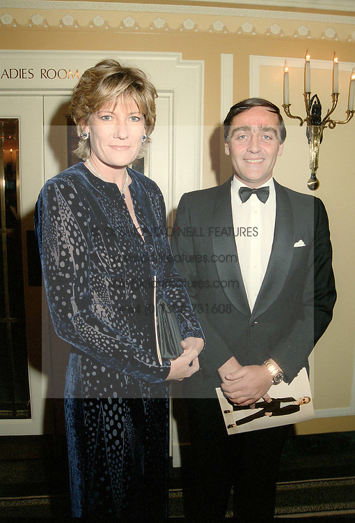The 6TH DUKE OF WESTMINSTER & the DUCHESS OF WESTMINSTER at a party in London in May 1996.