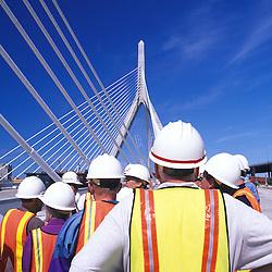 Construction workers on new Leonard P. Zakim-Bunker Hill Bridge, Boston, MA.