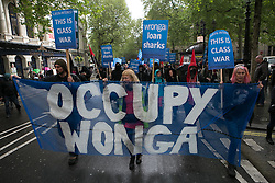 Occupy Wonga May Day. Protesters from Occupy against the Loan company Wonga in an improvised demonstration trough London from Trafalgar Square till the Wonga offices in front Harrington Square. Tottenham Court Road, London, United Kingdom. Thursday, 1st May 2014. Picture by Daniel Leal-Olivas / i-Images