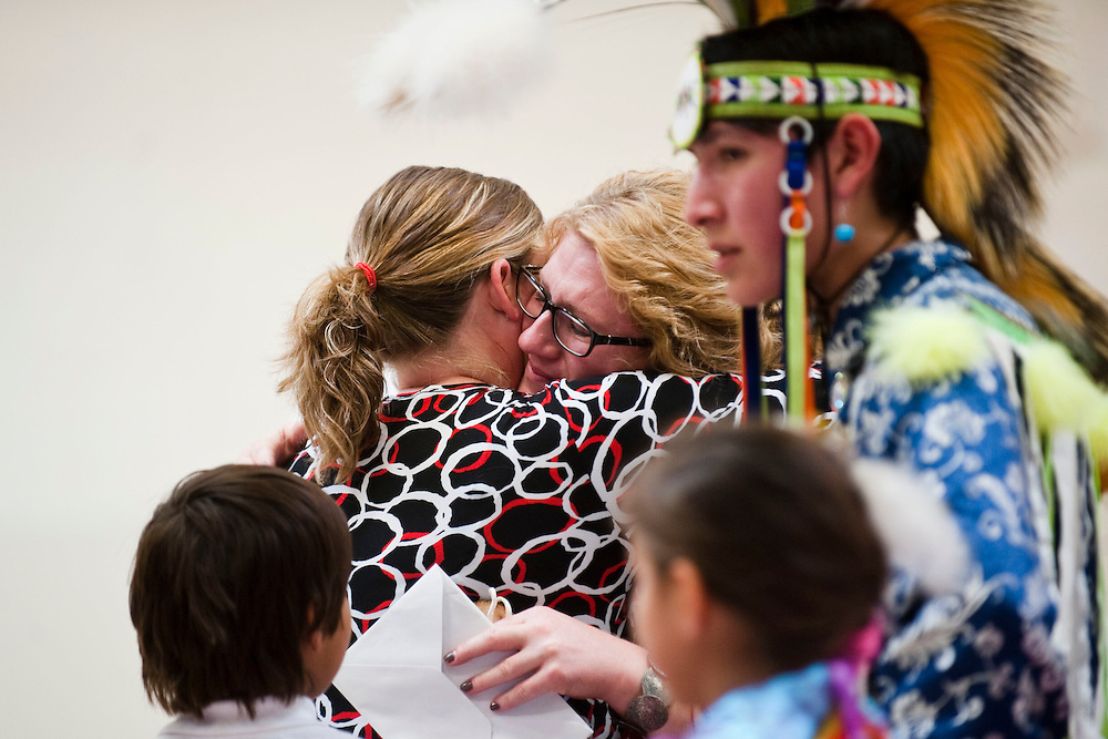 Students, family, board members, and friends of the school dance at The St. Augustine Pow Wow, held in the gymnasium, May 21, 2014. (Photo by Lauren Justice)