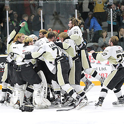 TRENTON, ON - Apr 22, 2016 -  Ontario Junior Hockey League game action between Trenton Golden Hawks and the Georgetown Raiders. Game 5 of the Buckland Cup Championship Series  at the Duncan Memorial Gardens in Trenton, Ontario. Trenton Golden Hawks players celebrate winning the Buckland Cup Championship.<br /> (Photo by Tim Bates / OJHL Images)