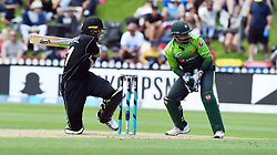 New Zealand's Martin Guptill, left, sweeps in front of Pakistan's Sarfraz Ahmed in the fifth one day International Cricket match, Basin Reserve, Wellington, New Zealand, Friday, January 19, 2018