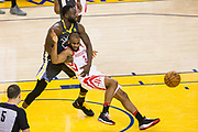 Golden State Warriors forward Draymond Green (23) fouls Houston Rockets guard Chris Paul (3) during Game 4 of the Western Conference Finals at Oracle Arena in Oakland, Calif., on May 22, 2018. (Stan Olszewski/Special to S.F. Examiner)