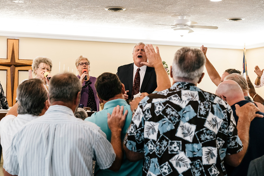 Pastor Chuck Donivan pray with church members during service at Full Gospel Pentecostal Church in Martinsburg, WV on June 4, 2017.