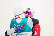 PYEONGCHANG-GUN, SOUTH KOREA - FEBRUARY 11: Martin Johnsrud Sundby of Norway gives a hug to Simen Hegstad Krueger of Norway after the Mens Skiathlon 15km+15km Cross-Country Skiing on day two of the PyeongChang 2018 Winter Olympic Games  at Alpensia Cross-Country Centre on February 11 in Pyeongchang-gun, South Korea. Photo by Nils Petter Nilsson/Ombrello               ***BETALBILD***
