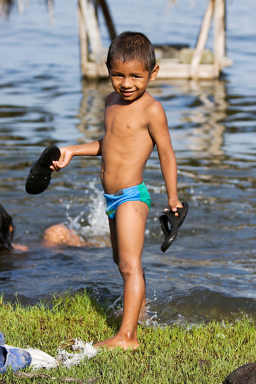A young boy bathes in the fresh water Lake Nicaragua