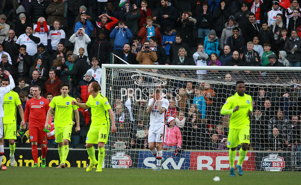 Milton Keynes Dons midfielder Carl Baker holds his head in his hands after missing a last-minute penalty during the Sky Bet Championship match between Milton Keynes Dons and Brighton and Hove Albion at stadium:mk, Milton Keynes, England on 19 March 2016. Photo by Bennett Dean.