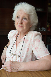 Portrait of older woman looking thoughtful,