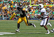 September 24, 2011: Iowa Hawkeyes running back Marcus Coker (34) tries to hold off Louisiana Monroe Warhawks cornerback Nate Brown (26) on a run during the second quarter of the game between the Iowa Hawkeyes and the Louisiana Monroe Warhawks at Kinnick Stadium in Iowa City, Iowa on Saturday, September 24, 2011. Iowa defeated Louisiana Monroe 45-17.