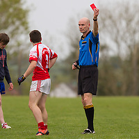Referee gives a red card during the U16 Division 1 Football FInal between Éire Óg and Ennistymon