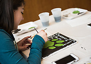 Carley Terry paints a bobcat canvas at the canvas-painting event hosted by Sigma Lambda Gamma National Sorority on the third floor of Baker Center on Feb. 3rd, 2018.
