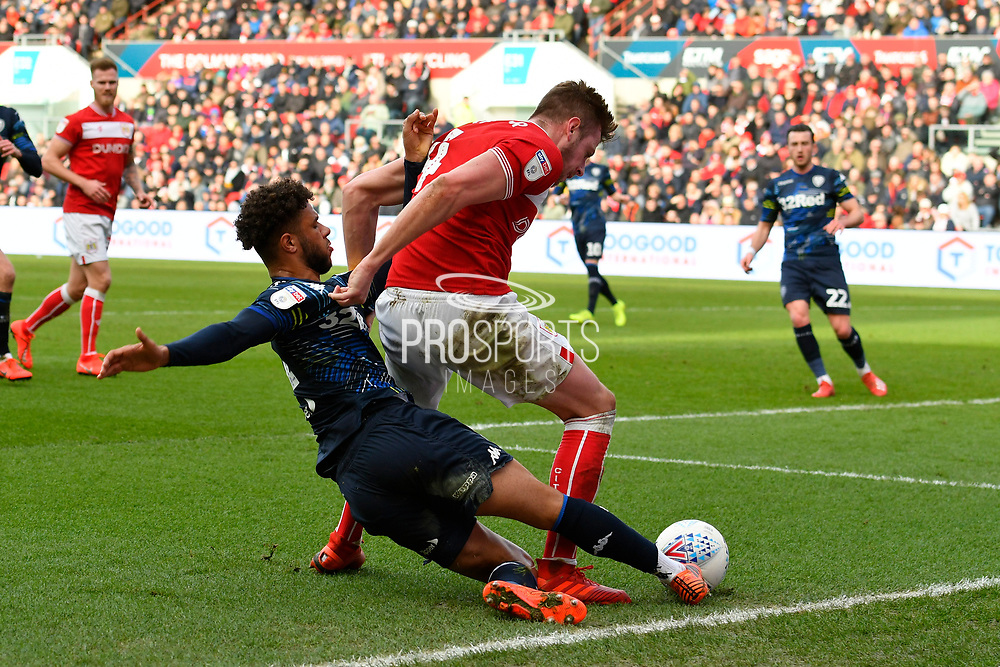 Tyler Roberts (11) of Leeds United is challnged by Adam Webster (4) of Bristol City during the EFL Sky Bet Championship match between Bristol City and Leeds United at Ashton Gate, Bristol, England on 9 March 2019.