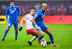 LEIPZIG, Feb. 26, 2019  Hoffenheim's Joelinton (R) controls the ball under the defense from Leipzig's Diego Demme during a German Bundesliga match between RB Leipzig and TSG 1899 Hoffenheim in Leipzig, Germany, on Feb. 25, 2019. The match ended in a 1-1 draw. (Credit Image: © Kevin Voigt/Xinhua via ZUMA Wire)