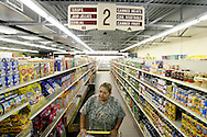 Life-long resident Mimi Nino browses the aisle of West's Model Market Wednesday, Aug. 10, 2011 as she does her grocery shopping in Premont. After years of poor facilities, bad test scores and attendance, the rural school district has been ordered to shut down by the Texas Education Agency. Nino, who is involved in the band boosters at the high school, wonders what will happen to the town if the school district shuts down and community-building events like Friday night football games are gone.