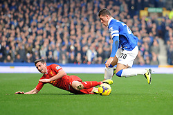 Liverpool's Joe Allen falls under a challenge from Everton's Ross Barkley - Photo mandatory by-line: Dougie Allward/JMP - Tel: Mobile: 07966 386802 23/11/2013 - SPORT - Football - Liverpool - Merseyside derby - Goodison Park - Everton v Liverpool - Barclays Premier League