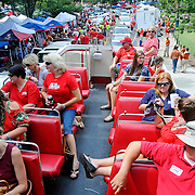 People ride the Double Decker bus around The Grove before an NCAA college football game between Mississippi and Texas in Oxford, Miss., Saturday, Sept. 15, 2012. (Photo/Thomas Graning)