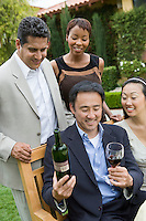 Friends celebrating with wine outdoors