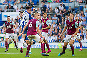 Aaron Connolly (Brighton) follows through after his header during the Premier League match between Brighton and Hove Albion and Burnley at the American Express Community Stadium, Brighton and Hove, England on 14 September 2019.