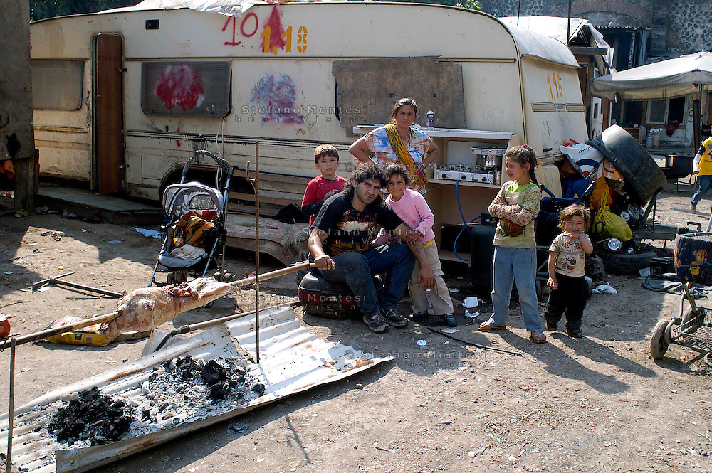 Rome May 6 2008.Rom's camp Casilino 900.Bosnian family cooking a lamb for lunch