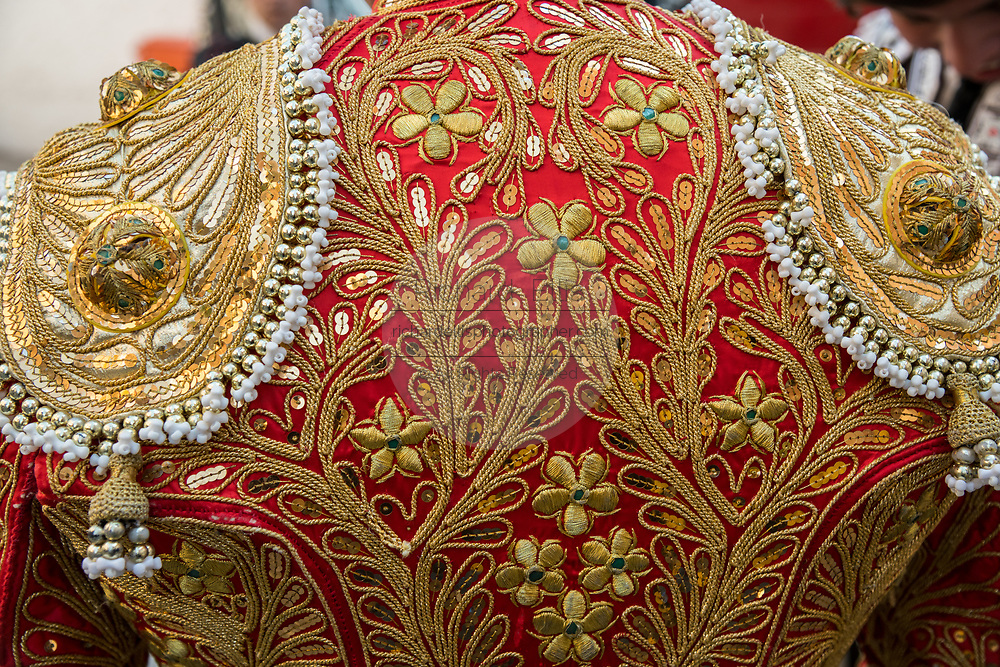 Detailed embroidery on the jacket back of a Mexican Matador as he prepares for the bullfights at the Plaza de Toros in San Miguel de Allende, Mexico. The handmade Matador clothing is called the traje de luces or suit of lights and originated in the 1700's.