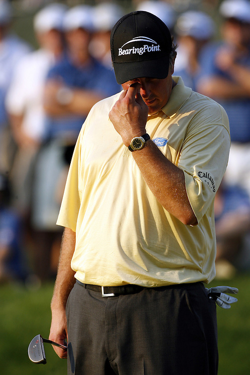 Phil Mickelson of the US reacts on the eighteenth hole before taking his last shot during the final day of the US Open Golf Championship at Winged Foot Golf Club in Mamaroneck, New York Sunday, 18 June 2006. Geoff Oglivy of Australia won the 106th US Open Championship with a 4-round score of 285 (+5)..
