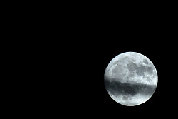 2016 November 13: Just a few stray clouds in the sky tonight with the moon in full phase and in a Super Moon cycle with the moon just a little closer to the earth.  Shot from a residence in Southeast Bloomington Illinois