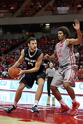 16 November 2014:  David Collette in the paint looking for a path past Reggie Lynch during an NCAA non-conference game between the Utah State Aggies and the Illinois State Redbirds.  The Aggies win the competition 60-55 at Redbird Arena in Normal Illinois.