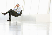 Business man sitting in empty room