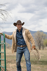 sexy cowboy in Winter on a ranch
