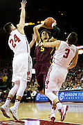 Guard Amir Coffey shoots through pressure during the first half of the University of Minnesota Men's Basketball game versus University of Wisconsin on March 5, 2017.