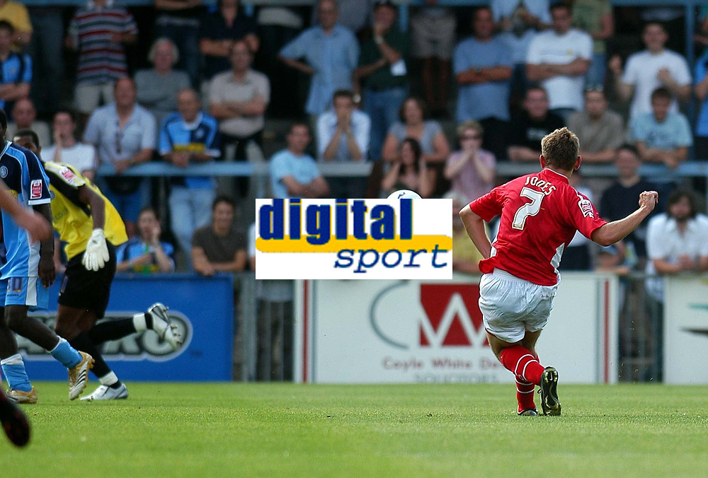 Photo: Alan Crowhurst.<br />Wycombe Wanderers v Wrexham. Coca Cola League 2.<br />05/08/2006. Wrexham's Mark Jones (R) scores from about 35 yards as Wycombe keeper Ricardo Batista is left strabded.