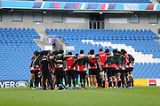 Japan players huddle for instructions during the Japan Captain's Run training session in preparation for the Rugby World Cup at the American Express Community Stadium, Brighton and Hove, England on 18 September 2015.